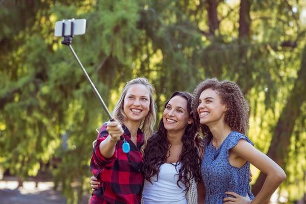 12207492-handsome-hipster-taking-a-selfie