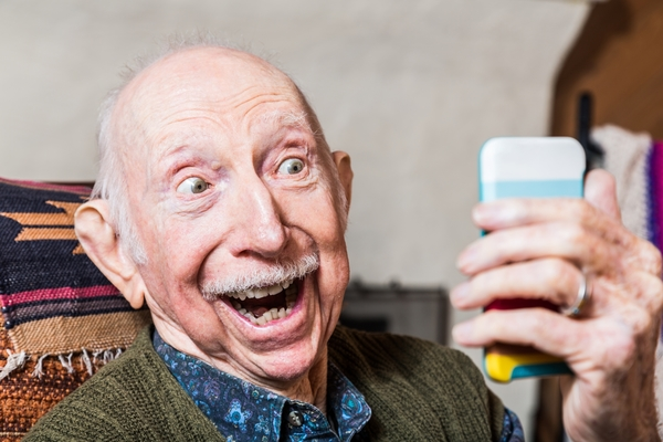 12645113-elderly-gentleman-with-smartphone