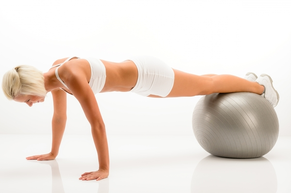 5747002-woman-gym-ball-pushups-at-white-fitness