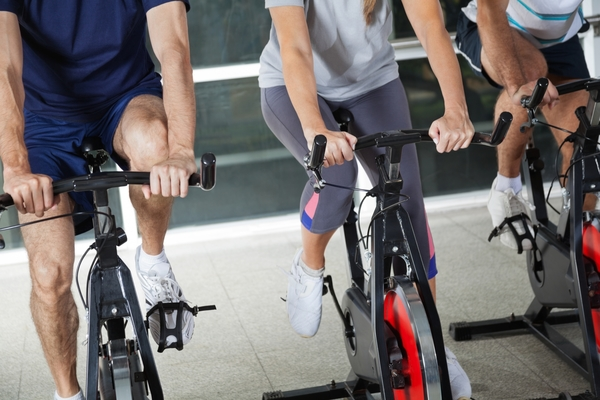 4355265-low-section-of-people-on-exercise-bikes