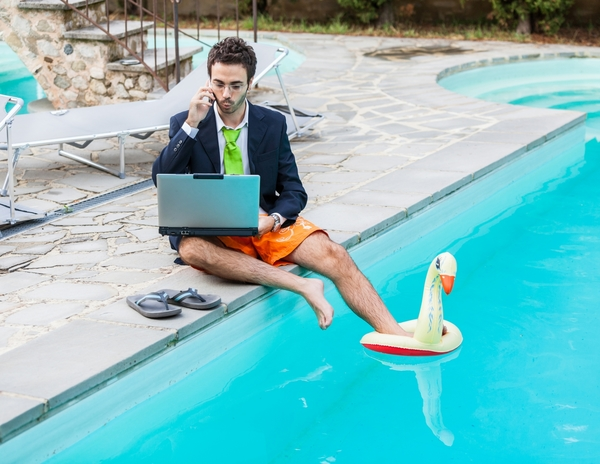 13026045-funny-young-businessman-with-swimmingtrunks-next-to-the-pool