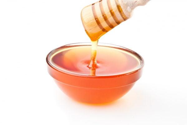 3593475-honey-dipper-on-top-of-a-bowl