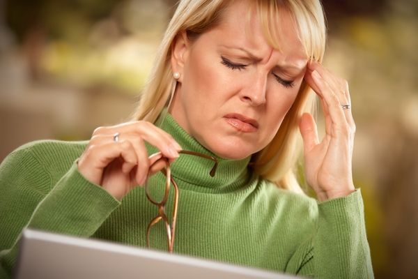 1093373-grimacing-woman-suffering-a-headache (1)