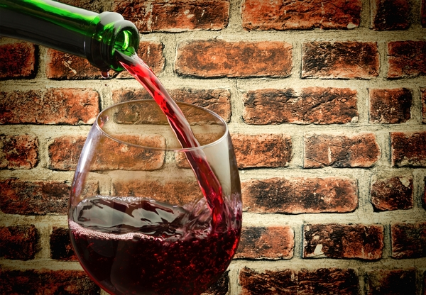 11385090-red-wine-being-poured-into-wine-glass