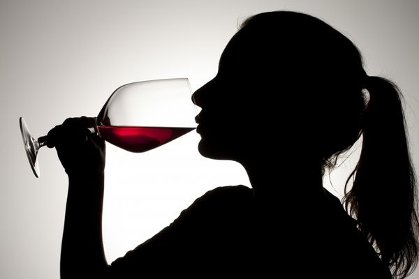 4361480-silhouette-of-a-girl-sipping-on-red-wine