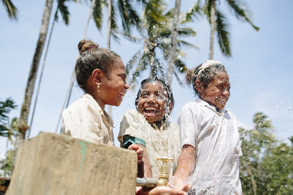 (Left to right) Fatima Da Costa, 11, Lourdes de Jesus, 9, and Amelia  Da Costa, 11, at one of the new tap stands in the village of Grotu in Manufahi District, Timor-Leste.