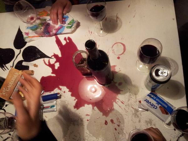 Red_wine_spilt_over_table
