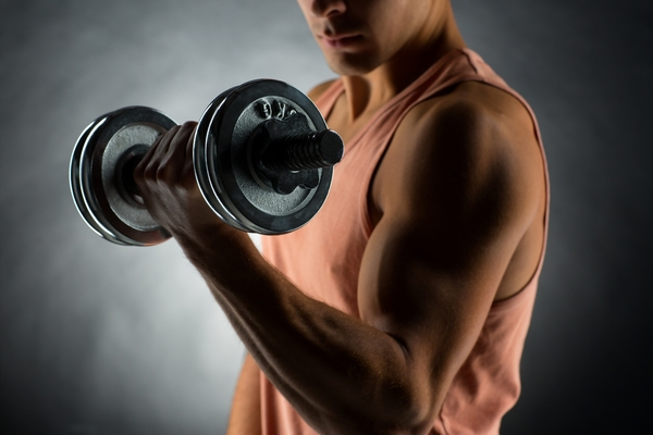 10088424-close-up-of-young-man-with-dumbbell