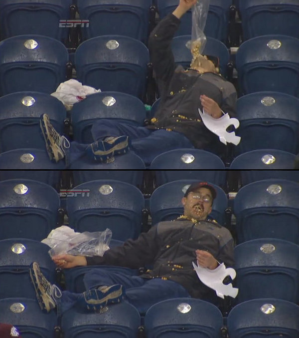 Drunk Man Eating Popcorn In The Rain At College Football Game - Imgur