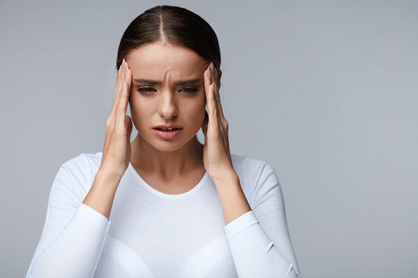 svettningar huvudvärk trötthet